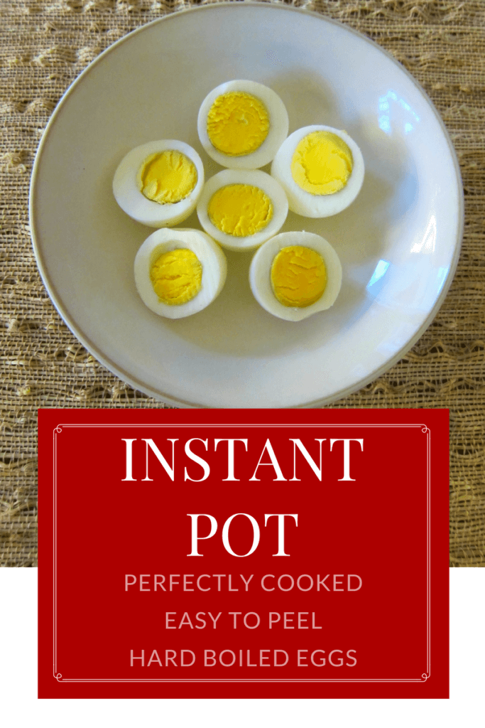 Instant Pot Hard Boiled Eggs cut up in a white bowl on a straw mat with red and white writing: Instant Pot Perfectly Cooked Easy to Peel Hard Boiled Eggs