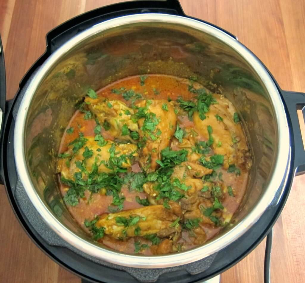 Indian Instant Pot Chicken Curry Finished in open Instant Pot with cilantro on top
