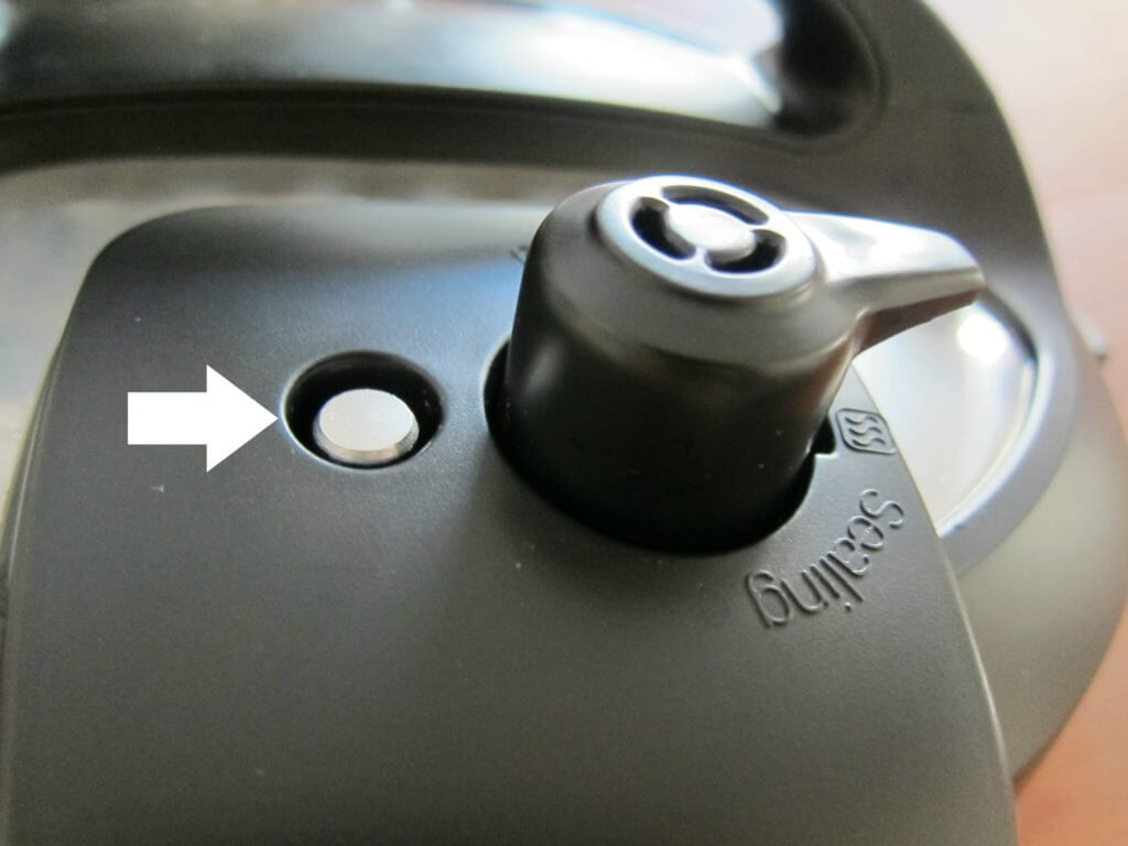 Instant Pot Manual - partial image of lid with arrow pointing to Float Valve Up