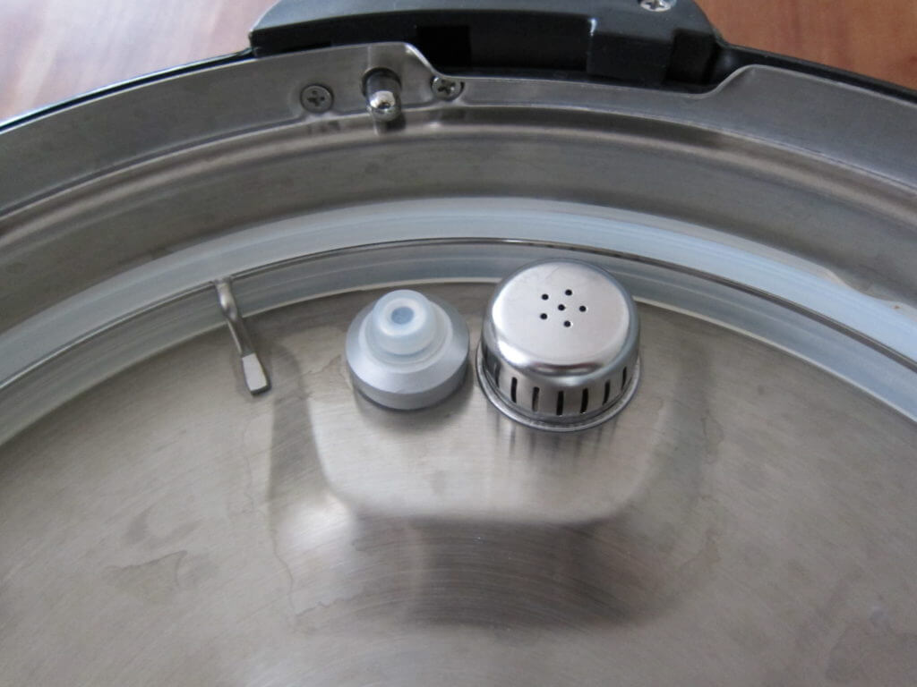 Instant Pot Manual - Partial view of Inside of Lid with sealing ring, float valve and anti block shield