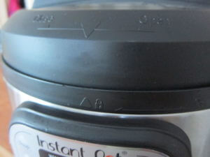 Instant Pot Manual - Lid with arrow on lid lined up with image of closed lock on external unit