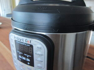 Instant Pot Manual - Lid with arrow on lid lined up with image of open lock on external unit