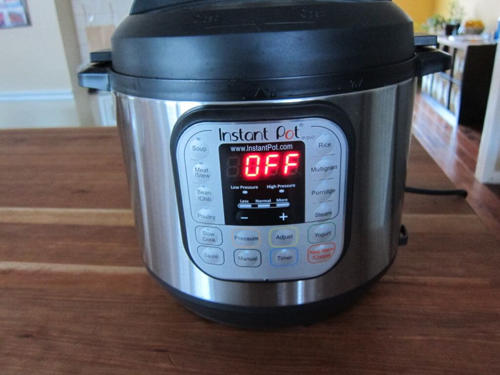Instant Pot Manual - Water Test Complete - Instant Pot on wooden countertop showing Off and no other lights on