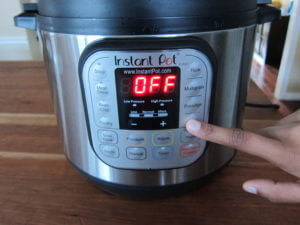 Instant Pot Manual - Water Test - Instant Pot on counter with finger pointing to Steam Button