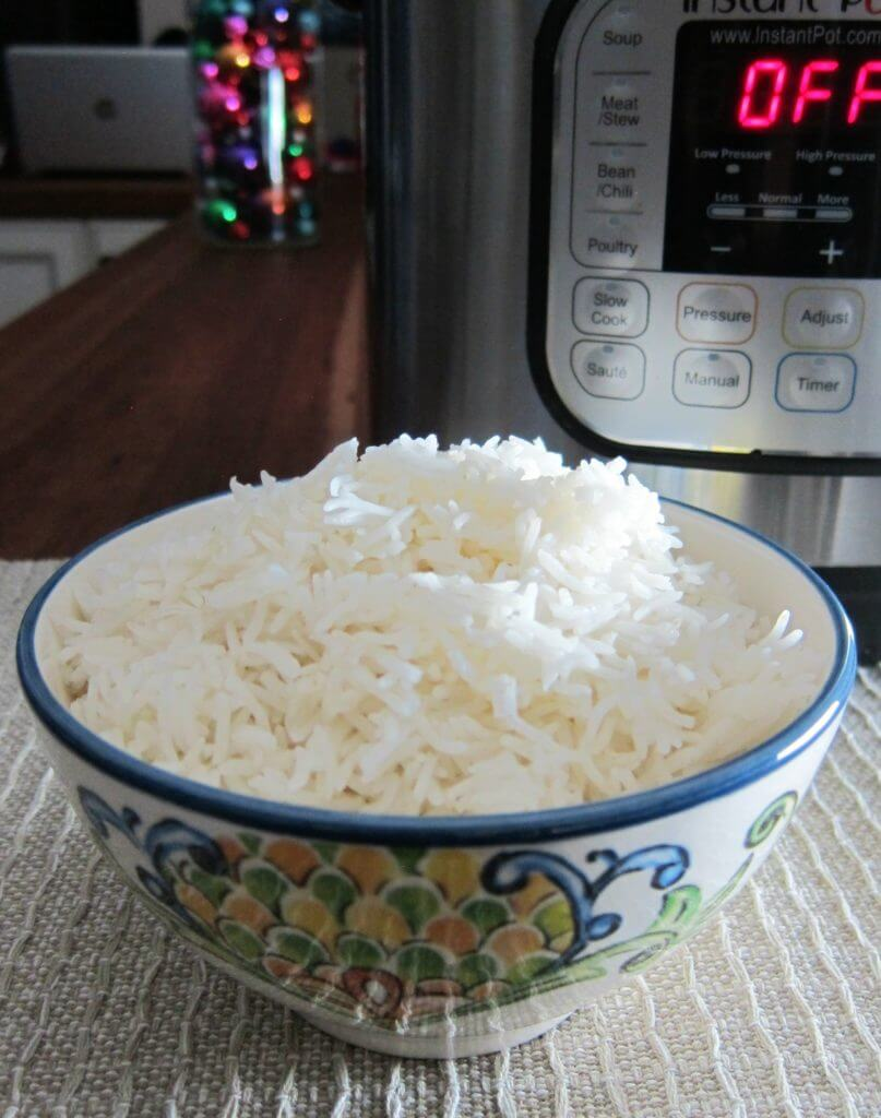 Instant Pot Rice Pot in Pot - rice in flowery bowl with instant pot in background