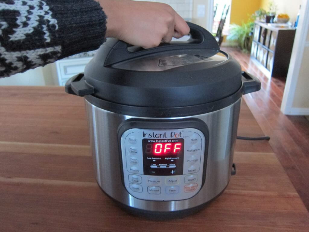 Instant Pot Manual - Water Test - Open Lid of Instant Pot on wooden countertop in kitchen