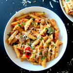 Instant Pot Pasta - Penne Sausage with Tomato Cream sauce in a white bowl Paint the Kitchen Red