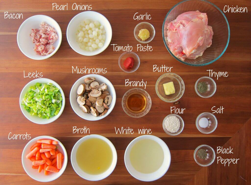 Instant Pot Coq au Vin Blanc Ingredients - Bacon, pearl onions, garlic, chicken, leeks, mushrooms, tomato paste, brandy, butter, thyme, carrots, broth, white wine, flour, salt, black pepper - Paint the Kitchen Red