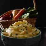 Instant Pot Mashed Potatoes and Parsnips in a turquoise bowl with basket of fresh vegetables in the background - Paint the Kitchen Red