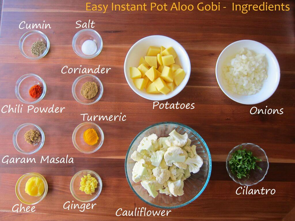 Instant Pot Aloo Gobi Ingredients - cumin, salt, chili powder, coriander, garam masala, turmeric, ghee, ginger, potatoes, onions, cauliflower, cilantro