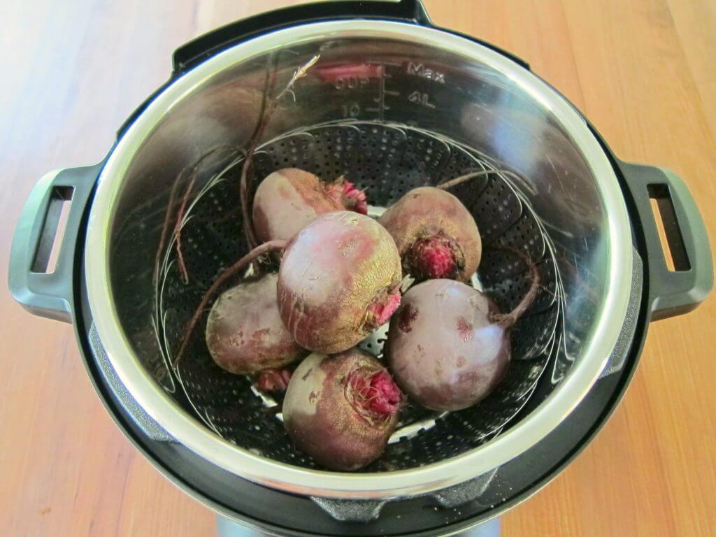 Instant Pot Beet Salad Beets in Inner Pot in steamer basket - Paint the Kitchen Red