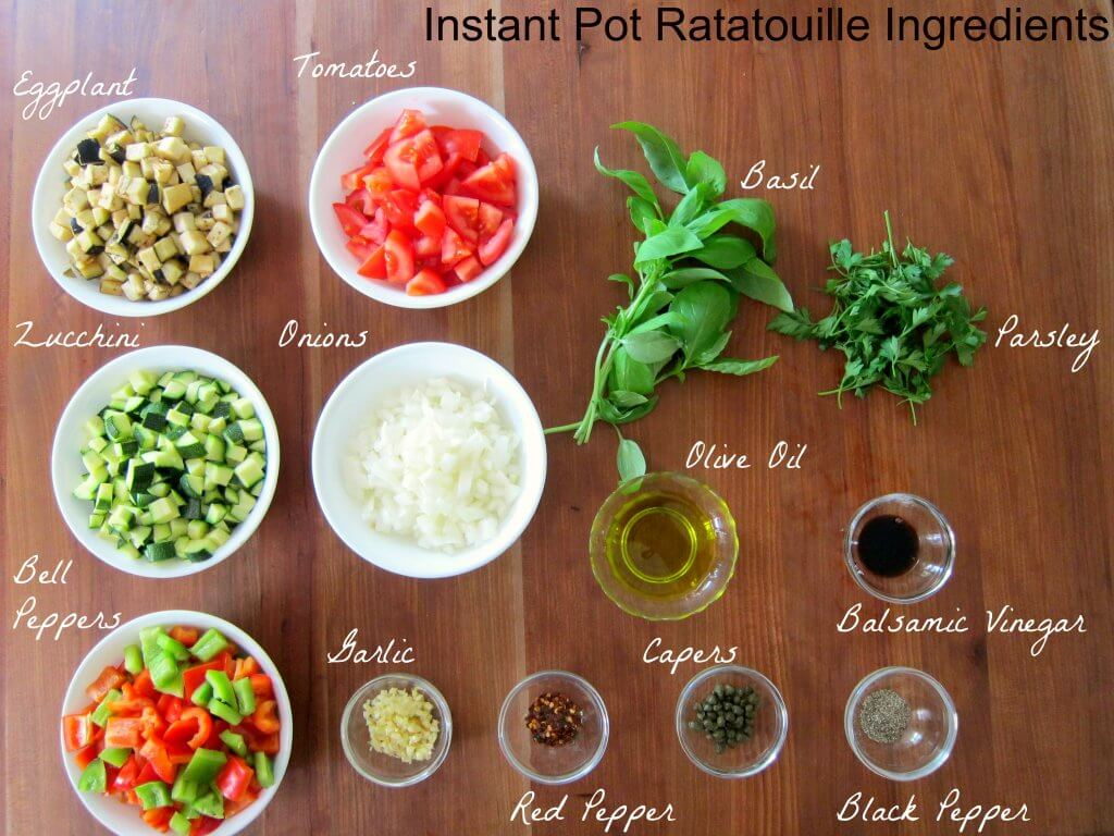Instant Pot Ratatouille Ingredients - eggplant, tomatoes, basil, parsley, zucchini, onions, olive oil, balsamic vinegar, bell peppers, garlic, red pepper, capers, balsamic vinegar, black pepper - Paint the Kitchen Red