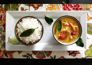 Instant Pot Pot in Pot Thai Curry and Rice in separate bowls on white serving dish over flowery placemat - Paint the Kitchen Red