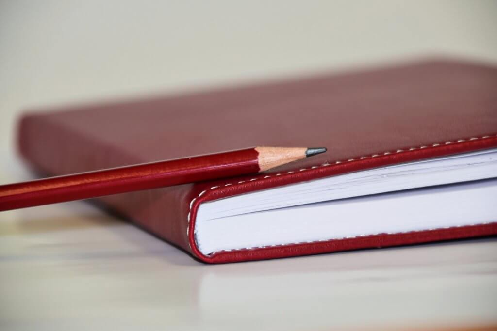 Instant Pot Tips - red recipe journal with red pencil