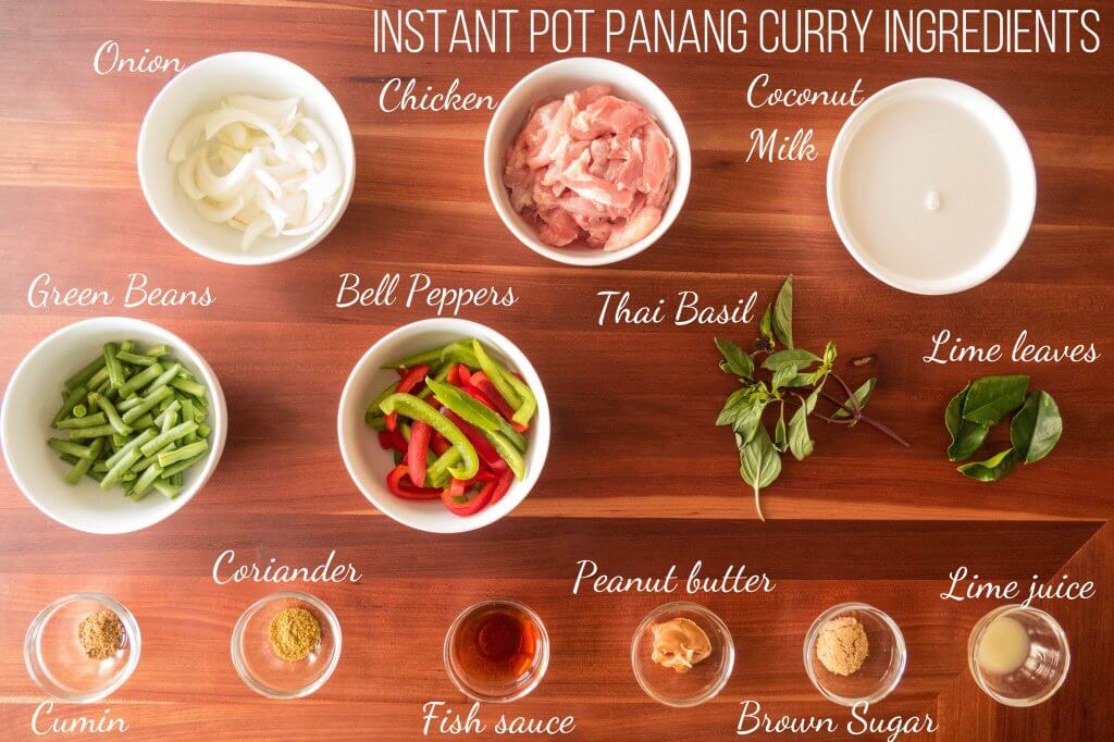 Instant Pot Panang Curry Ingredients - onion, chicken, coconut milk, green beans, bell peppers, thai basil, lime leaves, cumin, coriander, fish sauce, peanut butter, brown sugar, lime juice - Paint the Kitchen Red