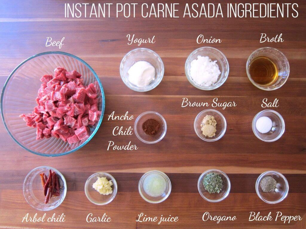 Instant Pot Carne Asada Ingredients - Beef, yogurt, onion, broth, ancho chili powder, brown sugar, salt, arbol chili, garlic, lime juice, oregano, black pepper - Paint the Kitchen Red