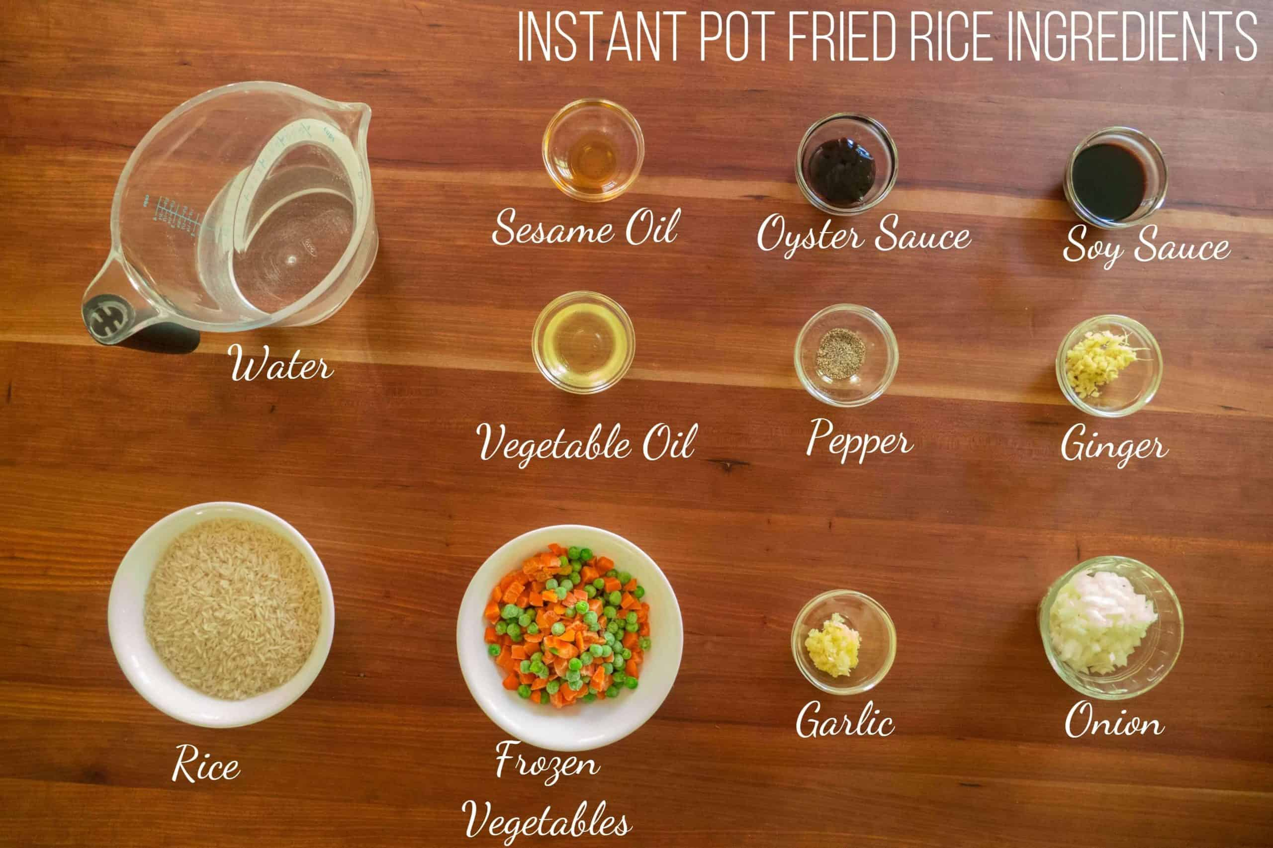 Instant Pot Fried Rice Ingredients - water, sesame oil, oyster sauce, soy sauce, vegetable oil, pepper, ginger, rice, frozen vegetables, garlic, onion