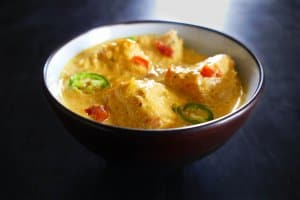 Instant Pot Indian Fish Curry in dark bowl
