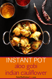 Instant Pot Aloo Gobi | Indian Cauliflower Pinterest pin - Cauliflower and potatoes with cilantro in metal bowl with bowls of Indian spices in the background - Paint the Kitchen Red