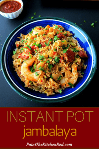 Instant Pot Jambalaya Pinterest pin - jambalaya with shrimp, sausage, parsley in blue bowl with hot sauce on the side