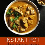 Instant Pot Massaman Curry Pinterest pin with Beef, potatoes, garnished with cilantro in white bowl with peanuts in background - Paint the Kitchen Red
