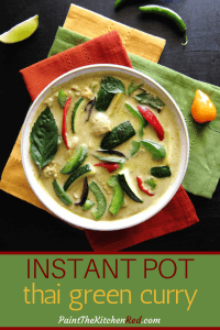 Instant Pot Thai Green Curry Pinterest pin with colorful green curry in white bowl on three colorful napkins. With lime slice and chilies on a black background. From Paint the Kitchen Red