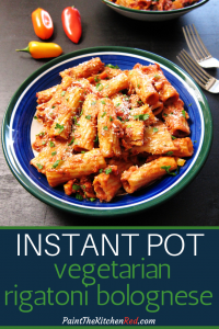 Instant Pot Rigatoni Bolognese Pinterest - bowl of rigatoni and sauce garnished with parmesan and parsley - Paint the Kitchen Red
