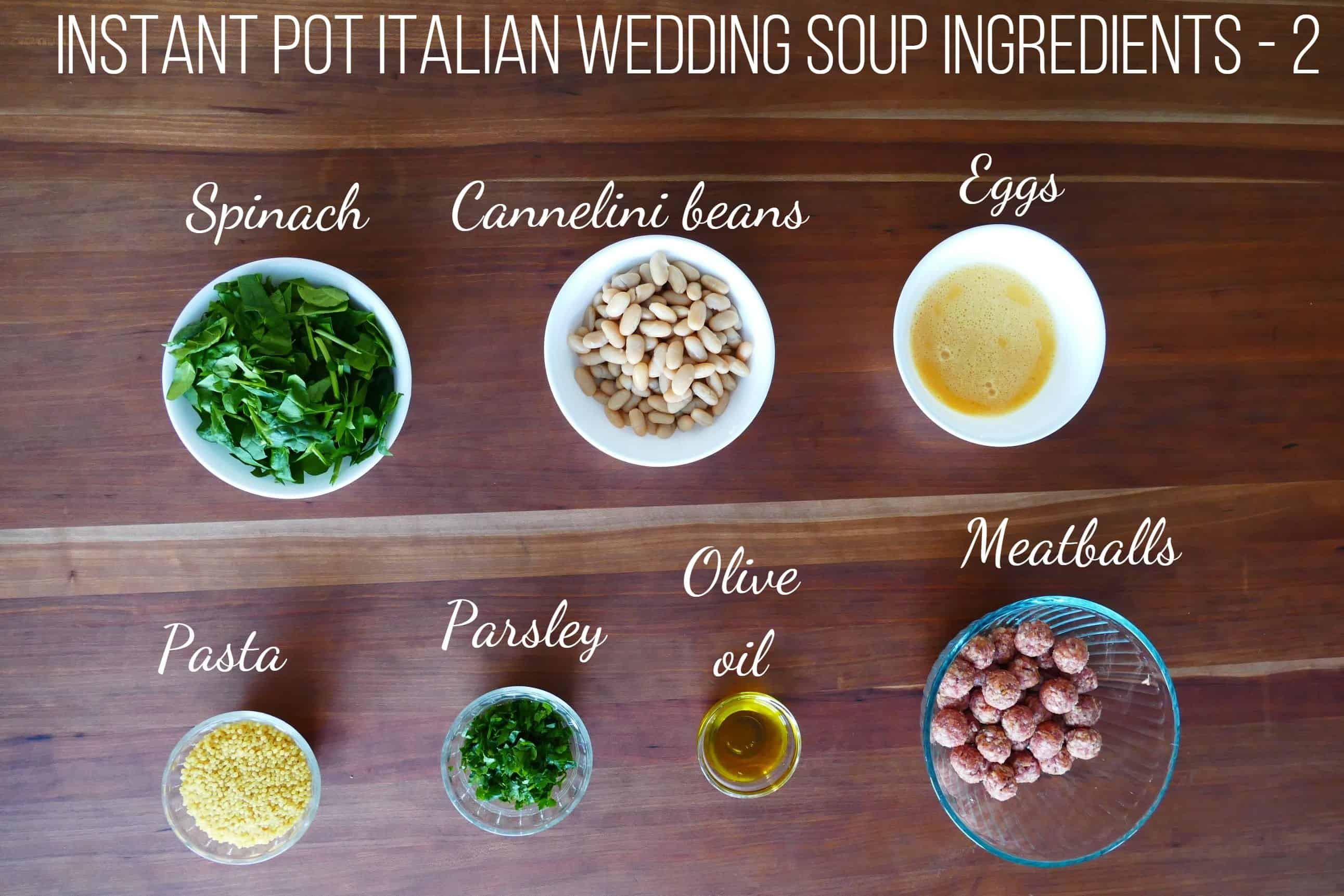 Instant Pot Italian Wedding Soup Ingredients 2 - spinach, cannelini beans, eggs, pasta, parsley, olive oil, meatballs - Paint the Kitchen Red