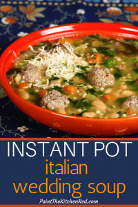 Instant Pot Italian Wedding Soup -Pinterest pin of orange bowl with beans, carrots, meatballs, spinach, parmesan and bread and empty bowls in the background- Paint the Kitchen Red