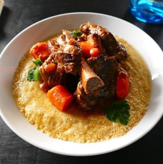 Instant Pot Short Ribs L1 - short ribs on polenta creamy with carrots and parsley - Paint the Kitchen Red