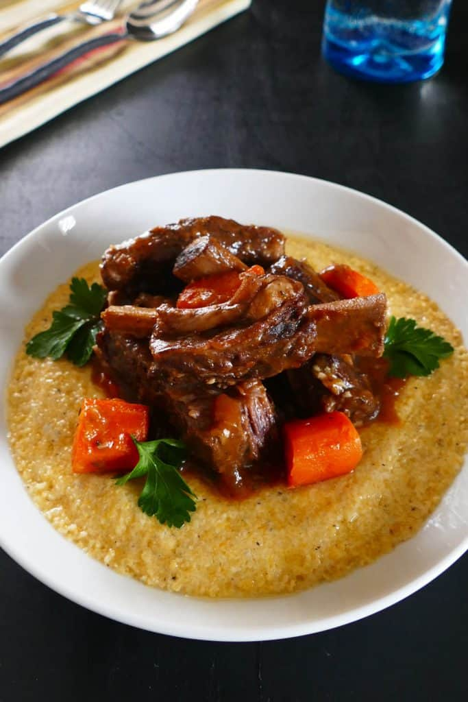 Instant Pot Short Ribs P1 - short ribs on polenta creamy with carrots and parsley - Paint the Kitchen Red