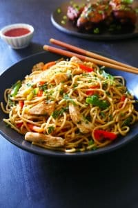Instant Pot Thai Peanut Noodles in black bowl garnished with cilantro - Paint the Kitchen Red
