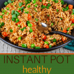 Instant Pot Brown Fried Rice Pinterest pin - black bowl with rice, peas, carrots, green onions and a serving spoon - Paint the Kitchen Red