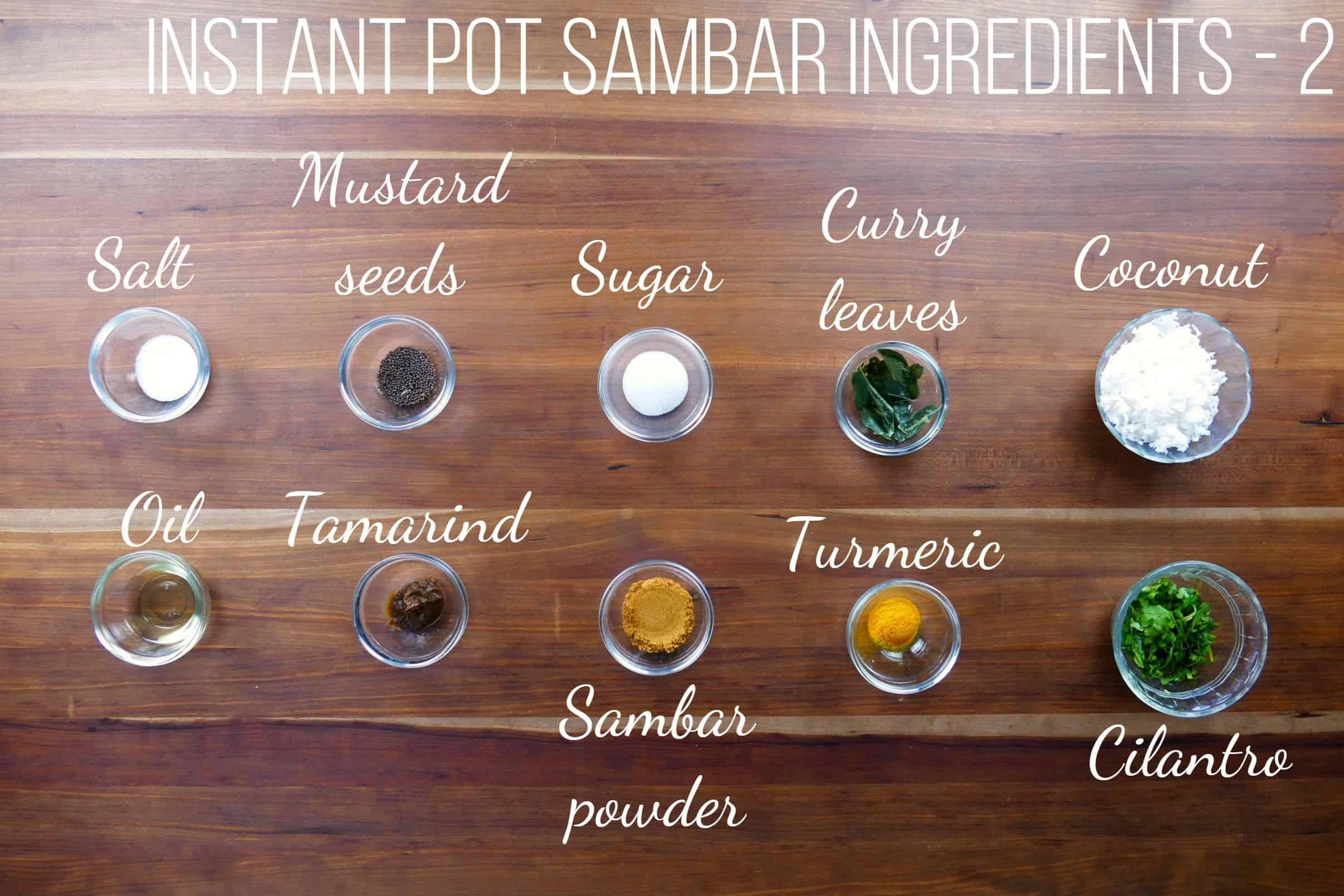 Instant Pot Sambar Ingredients 2 - salt, mustard seeds, sugar, curry leaves, coconut, oil, tamarind, sambar powder, turmeric, cilantro