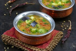 Instant Pot Sambar L1 - two bowls of sambar with tomatoes, eggplant okra, garnished with cilantro