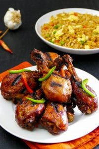 Instant Pot Korean Chicken - plate of grilled chicken with fried rice in background - Paint the Kitchen Red