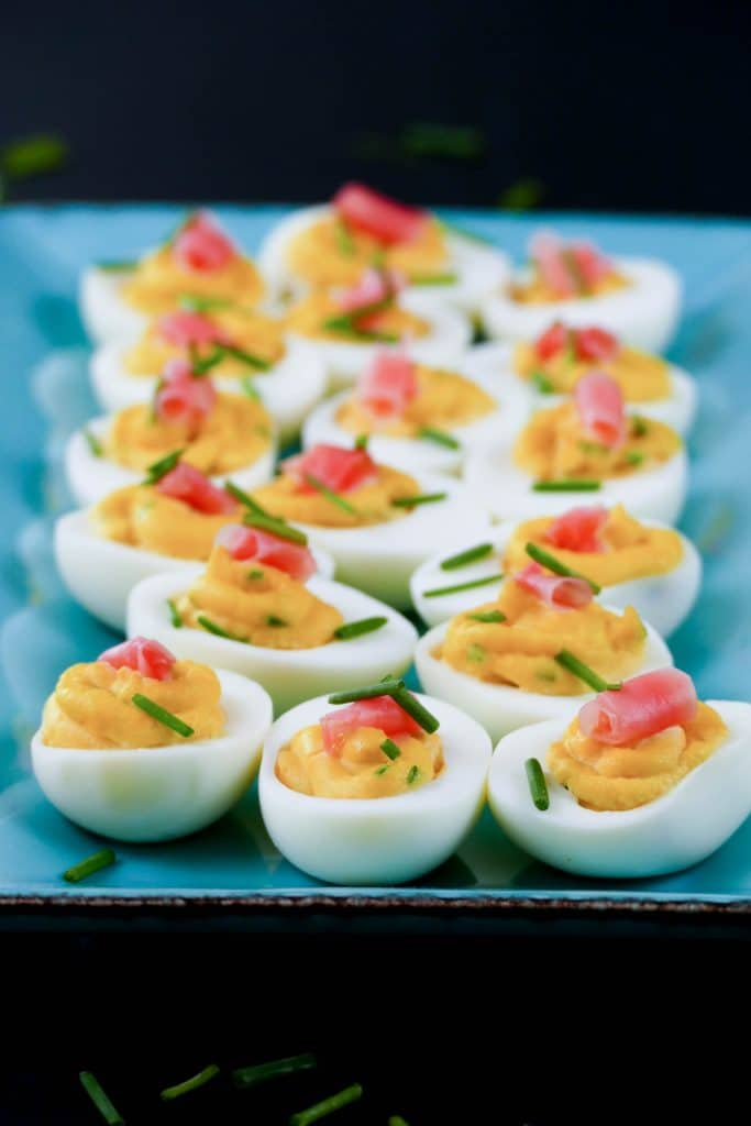 Wasabi Instant Pot Deviled Eggs with wasabi and pickled ginger on colorful blue plate - Paint the Kitchen Red