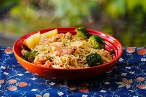 Instant Pot Shrimp Pasta with Garlic, parmesan, broccoli with lemon wedges in orange bowl - Paint the Kitchen Red