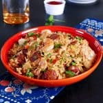 Instant Pot Jambalaya in orange bowl with shrimp, sausage and rice - Paint the Kitchen Red