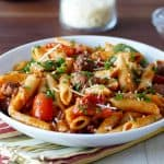 Instant Pot Pasta - Penne Sausage with Tomato Cream sauce in a white bowl- Paint the Kitchen Red