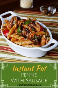 Instant Pot Pasta - Penne Sausage with Tomato Cream sauce in a white oval serving bowl- Paint the Kitchen Red