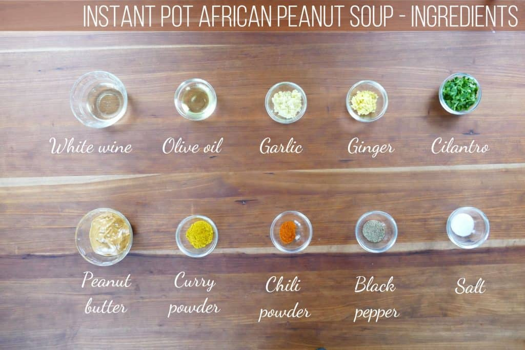 Instant Pot African Peanut Soup ingredients - white wine, olive oil, garlic, ginger, cilantro, peanut butter, curry powder, chili powder, black pepper, salt