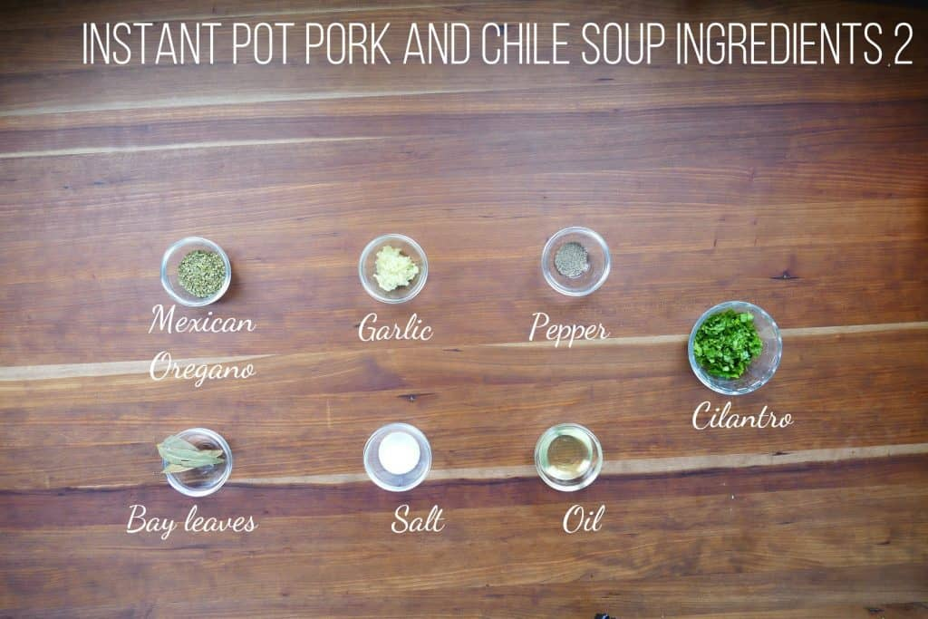 Instant Pot Pork and Hatch Chile Soup Ingredients 1 - mexican oregano, garlic, pepper, bay leaves, salt, oil, cilantro