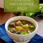 Instant Pot Pork and Hatch Chile Soup pinterest pin for soup in a white bowl on a blue napkin