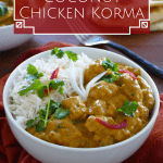 Instant Pot coconut chicken korma curry pinterest pin with rice in a bowl with naan bread in the background