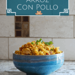 Pinterest pin with blue bowl on counter with yellow rice, peas, chicken topped with cilantro