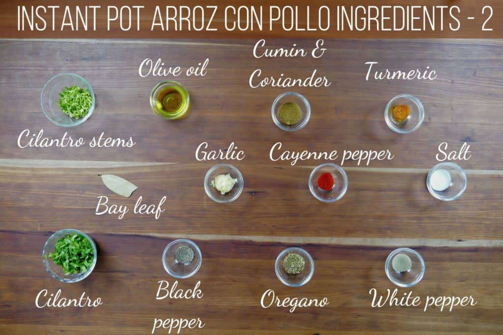 instant pot arroz con pollo ingredients - cilantro stems, olive oil, cumin & coriander, turmeric, bay leaf, garlic, cayenne pepper, salt, cilantro, black pepper, oregano, white pepper - Paint the Kitchen Red