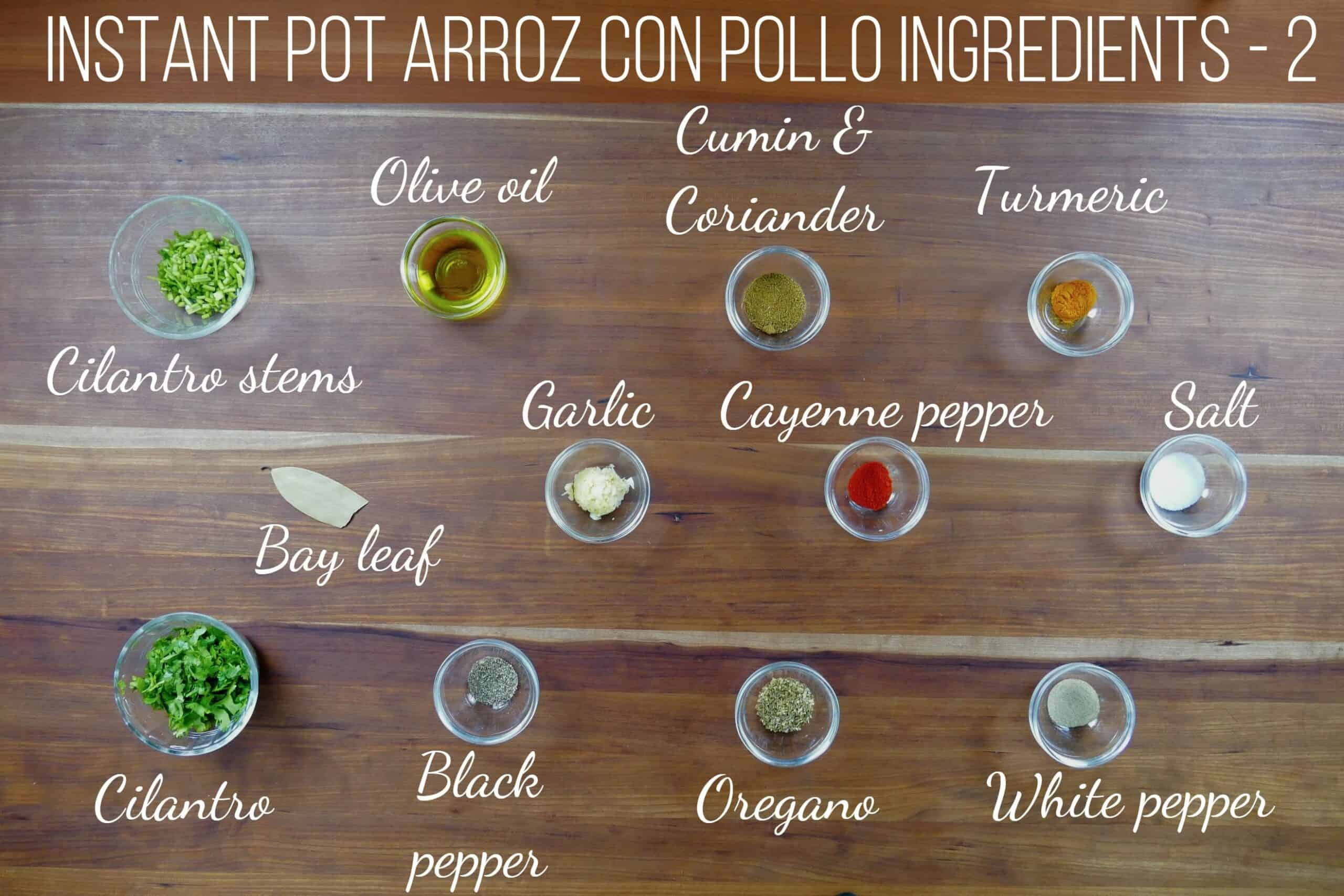 instant pot arroz con pollo ingredients - cilantro stems, olive oil, cumin & coriander, turmeric, bay leaf, garlic, cayenne pepper, salt, cilantro, black pepper, oregano, white pepper - Paint the Kitchen Red