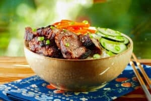 Instant Pot Char Siu - Chinese bbq pork in a bowl with rice, cucumbers and bell peppers