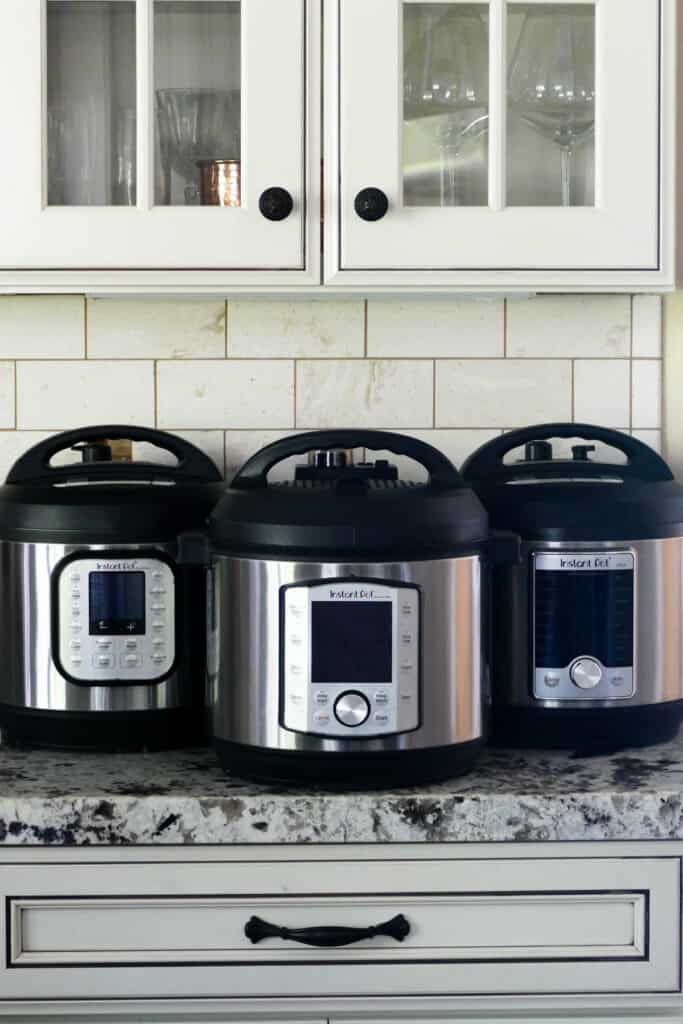 Three Instant Pots side by side on countertop